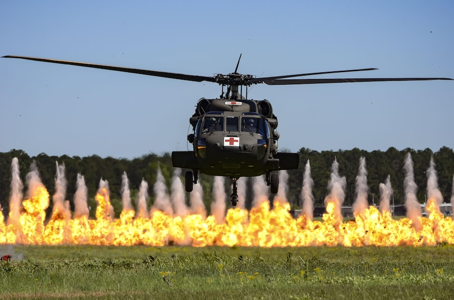 A UH-60 Black Hawk helicopters hovers while a wall of fire burns during the South Carolina National Guard Air and Ground Expo combined arms demonstration at McEntire Joint National Guard Base, South Carolina, May 7, 2017. This expo is a combined arms demonstration showcasing the abilities of South Carolina National Guard Airmen and Soldiers while saying thank you for the support of fellow South Carolinians and the surrounding community. (U.S. Air National Guard photo by Tech. Sgt. Nicole Szews)