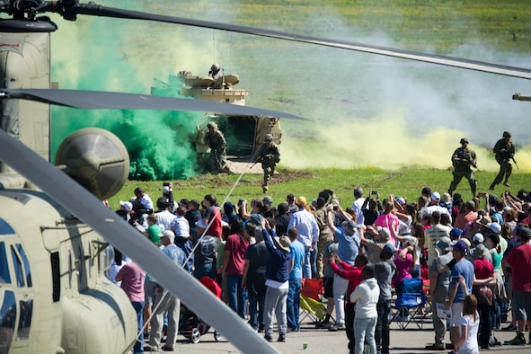 Spectators watch the air and ground demonstrations at the South Carolina National Guard Air and Ground Expo at McEntire Joint National Guard Base, South Carolina, May 7, 2017. This expo is a combined arms demonstration showcasing the capabilities of South Carolina National Guard Airmen and Soldiers while saying thank you for the support of fellow South Carolinians and the surrounding community. (U.S. Air National Guard photo by Tech. Sgt. Jorge Intriago)