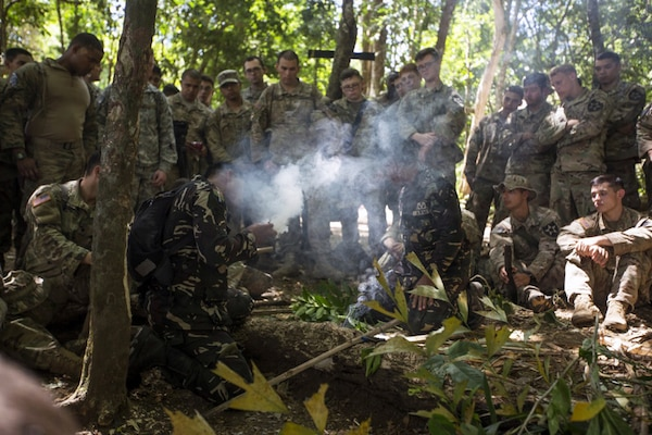 Philippine Special Forces demonstrate to U.S. Soldiers, 1st Battalion, 23rd Infantry Regiment, how to make a fire from bamboo shoots during a subject matter expert exchange in support of Balikatan 2017 at Fort Magsaysay in Santa Rosa, Nueva Ecija, May 13, 2017.  U.S. Soldiers trained with Philippine Special Forces to understand the Armed Forces of the Philippines' techniques for operating in a jungle environment. Balikatan is an annual U.S.-Philippine bilateral military exercise focused on a variety of missions, including humanitarian and disaster relief, counterterrorism, and other combined military operations.