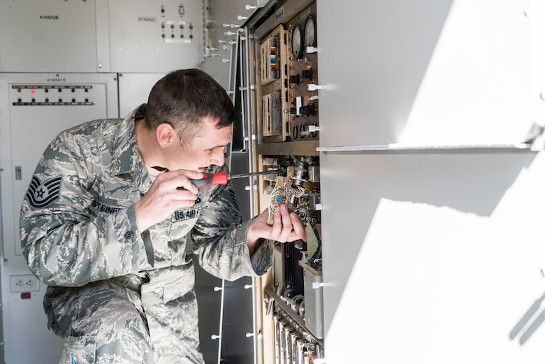 Tech. Sgt. Aaron Steinberg, 266th Range Squadron ground radar technician, installs a power supply on the Multiple Threat Emitter System at the Mountain Home Air Force Base Range Complex in Idaho May 9, 2017. The $20,000 power supply was broken and headed for the garbage, but the Air Force Repair Enhancement Program team managed to fix the part by replacing a $5 resistor. (U.S. Air Force photo/Staff Sgt. Samuel Morse)
