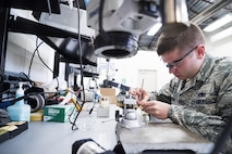 Staff Sgt. Zachary Dowd, Air Force Repair Enhancement Program circuit card technician, replaces a resistor on a power supply at Mountain Home Air Force Base, Idaho, May 8, 2017. The four-person AFREP team saved the Air Force a combined $1.3 million in 2016, and is on-track to save $2.5 million in 2017, between cost savings and cost avoidance. (U.S. Air Force photo/Staff Sgt. Samuel Morse)