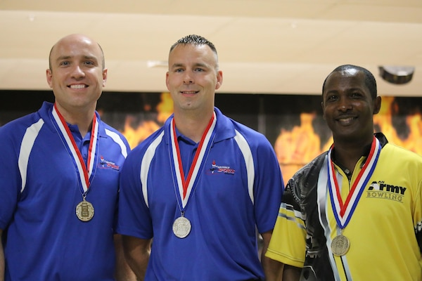 Air Force Staff Sgt. James McTaggart of Nellis AFB, Nevada; Tech. Sgt. Chuck Kropog of Yokota, Air Base, Japan; and Army Sgt. 1st Class Damian Codrington of Fort Hood, Texas take gold, silver and bronze respectively at the Armed Forces Bowling Championship hosted at Marine Corps Base Camp Pendleton, California from 5-8 May at the Leatherneck Lanes.