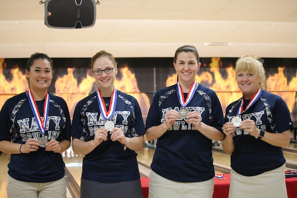 Navy Women take Team Silver at the Armed Forces Bowling Championship hosted at Marine Corps Base Camp Pendleton, California from 5-8 May at the Leatherneck Lanes. Pictured is: Petty Officer 1st Class Melanie Griffith, USS Essex; Petty Officer 1st Class Ashley Scott, Navy Reserve COM; Senior Chief Petty Officer Debbee Simon, San Diego, CA; Cmdr. 	Tamara Tuttle, Groton, Conn.