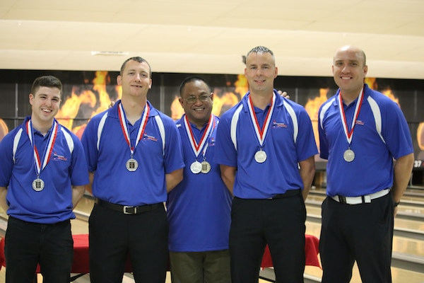Air Force Men take Team Silver at the 2017 Armed Forces Bowling Championship hosted at Marine Corps Base Camp Pendleton, California from 5-8 May at the Leatherneck Lanes. Picture here is: Tech. Sgt. Chuck Kropog, Yokota AB, Japan; Tech. Sgt. Hans Schnell, Peterson AFB, Colo.; Staff Sgt. James McTaggart, Nellis AFB, Neveda; Staff Sgt. Marshal Crider, Ramstein AB, Germany