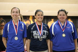 From left to right: Gold medalist Air Force Capt. Danielle Crowder of Little Rock AFB,Arkansas; Silver medalist Navy Petty Officer 1st Class Melanie Griffith of the USS Essex; and Air Force Staff Sgt. Natasha Sanchez of Travis AFB, California on the podium at the 2017 Armed Forces Bowling Championship hosted at Marine Corps Base Camp Pendleton, California from 5-8 May at the Leatherneck Lanes.