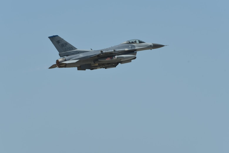 A U.S. Air Force F-16 Fighting Falcon flies above Kunsan Air Base, Republic of Korea, May 15, 2017. Six aircraft from the 35th Fighter Squadron departed Kunsan to participate in Buddy Wing 17-4. The exercise enhances interoperability between U.S. and ROK forces for combined operations. (U.S. Air Force photo by Senior Airman Michael Hunsaker/Released)