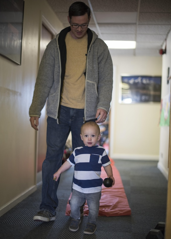A  U.S. Air Commando assigned to the 352d Special Operations Wing and his son walk from one activity to another during Roald Dahl day at the Preservation of the Force and Family building May 13, 2017 on RAF Mildenhall, England. The POTFF mission is to build and implement a holistic approach to address the pressure on military members and their families. This event was one of many regular 352 SOW programs which reinforce resilience techniques and methods for resolving challenges associated with special operations service. (U.S. Air Force photo by Capt Chris Sullivan)