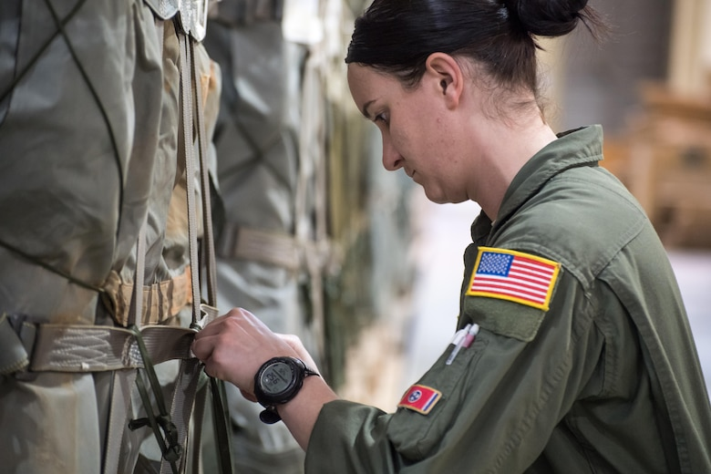 Staff Sgt. Casey Jackson, a 43d Operations Support Squadron joint airdrop inspector, inspects straps on a Container Delivery System -- or CDS -- while conducting an inspection of cargo at the Army's Heavy Drop Rigging Facility here April 26. Jackson worked with fellow 43d OSS inspectors to ensure more than 200 tons of cargo were ready for airdrop from Air Force C-17s and C-130s flying out of Pope Field during a large package joint training exercise April 26-30. The 43d OSS is part of the Air Force's 43d Air Mobility Operations Group, which provides 24/7 operational and training mission support for visiting Air Mobility Command aircraft and crews, for the 82nd Airborne Division and other Army units here, and for joint special forces units at Fort Bragg. (U.S. Air Force photo/Marc Barnes)