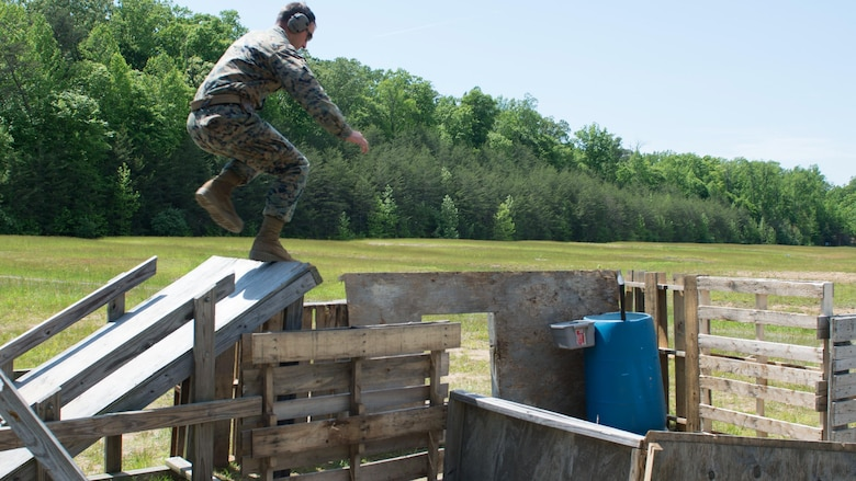 Staff Sgt. Christopher Sherrill, a competition shooter, jumps over an obstacle during the Marine Corps Championships at Marine Corps Base Quantico, Virginia, May 10, 2017. Each year, the Marine Corps Shooting Team hosts the championship matches for medalists from each Marine Corps Markmanship Competition site to compete in individual and team matches.