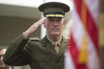 Marine Corps Gen. Joe Dunford, chairman of the Joint Chiefs of Staff, renders honors during the 30th Annual Vietnam Remembrance and Wreath Laying Ceremony held at the Vietnam Veterans Memorial Clock Tower in Quincy, Mass., April 27, 2017. Each year, the names of the 48 Quincy residents who died during the Vietnam War are read during a memorial roll call at the clock tower. DoD photo by Navy Petty Officer 2nd Class Dominique A. Pineiro