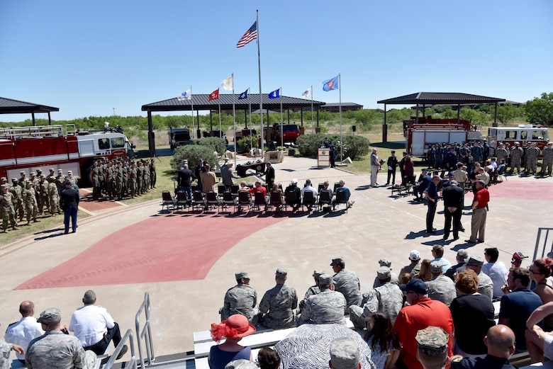 The 312th Training Squadron finalizes preparations for the memorial service at the Department of Defense Fallen Firefighter Memorial on Goodfellow Air Force Base, Texas, May 12, 2017. Each of the military services had a formation there to represent the joint training at the Louis F. Garland Department of Defense Fire Academy and to pay respect to the five fallen firefighters. (U.S. Air Force photo by Staff Sgt. Joshua Edwards/Released)