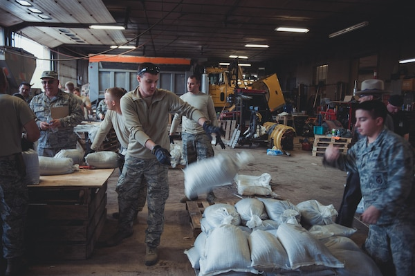 Airmen assigned to the 107th Attack Wing of the New York Air National Guard fill sandbags at the Kendall, N. Y. town garage on May 11, 2017, as part of the New York National Guard response to high water levels in Lake Ontario which resulted in local flooding. Between May 3 and May 13, 323 New York National Guard Soldiers and Airmen filled 239, 239,703 sandbags at six locations in counties along the lake.