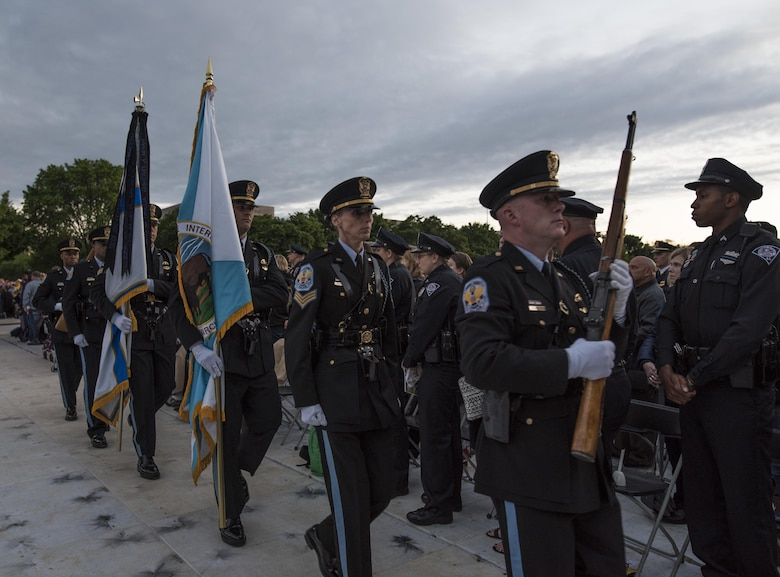 The United States Park Police Honor Guard exits the stage during the opening ceremony of the 29th Annual Candlelight Vigil honoring fallen police officers from around the country on the National Mall in Washington, D.C., May 13, 2017. Approximately 300 police officers' names were read, engraved into the National Police Memorial. Among those names was Staff Sgt. James D. McNaughton, a U.S. Army Reserve military police who was the first New York City police officer killed in action while deployed to Iraq, Aug. 2, 2005. (U.S. Army Reserve photo by Sgt. Audrey Hayes)