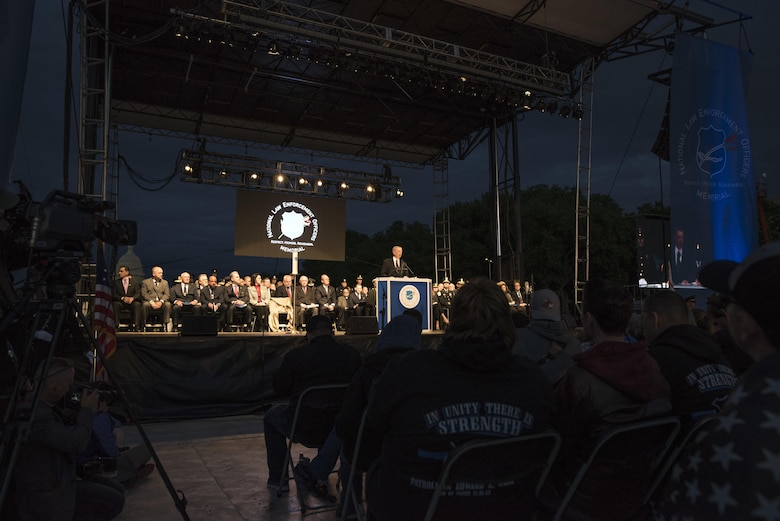 Police officers and family members attend the 29th Annual Candlelight Vigil honoring fallen police officers from around the country on the National Mall in Washington, D.C., May 13, 2017. Approximately 300 police officers' names were read, engraved into the National Police Memorial. Among those names was Staff Sgt. James D. McNaughton, a U.S. Army Reserve military police who was the first New York City police officer killed in action while deployed to Iraq, Aug. 2, 2005.