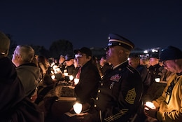 Command Sgt. Maj. Craig Owens, the senior enlisted leader for the 200th Military Police Command, attends the 29th Annual Candlelight Vigil honoring fallen police officers from around the country Saturday, on the National Mall in Washington, D.C., May 13, 2017. Approximately 300 police officers' names were read, engraved into the National Police Memorial. Among those names was Staff Sgt. James D. McNaughton, a U.S. Army Reserve military police who was the first New York City police officer killed in action while deployed to Iraq, Aug. 2, 2005.