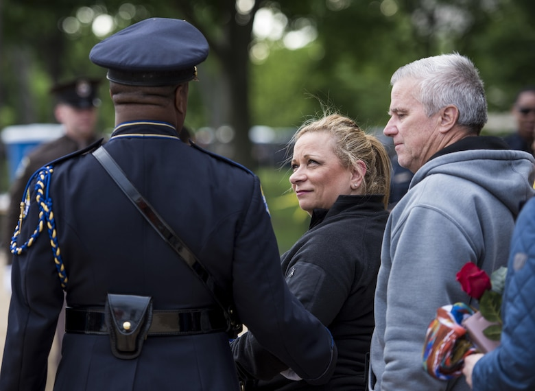 William and Michele McNaughton, from Centereach, New York, are escorted to their seat during the 29th Annual Candlelight Vigil to represent their son on the National Mall in Washington, D.C., May 13, 2017. McNaughton was a U.S. Army Reserve military police who was the first New York City police officer killed in action while deployed to Iraq, Aug. 2, 2005. Approximately 300 police officers' names were read, engraved into the National Police Memorial. (U.S. Army Reserve photo by Sgt. Audrey Hayes)