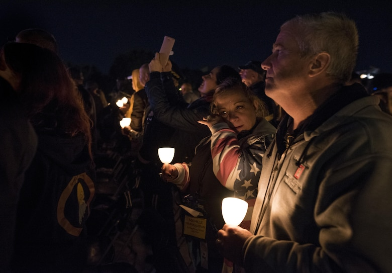 Michele McNaughton wipes tears from her face while remembering her son, Staff. Sgt. James D. McNaughton during the 29th Annual Candlelight Vigil, honoring fallen police officers from around the country on the National Mall in Washington, D.C., May 13, 2017. McNaughton was a U.S. Army Reserve military police who was the first New York City police officer killed in action while deployed to Iraq, Aug. 2, 2005. Approximately 300 police officers' names were read, engraved into the National Police Memorial. (U.S. Army Reserve photo by Sgt. Audrey Hayes)