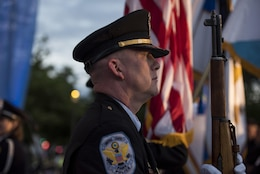 A member of the United States Park Police Honor Guard presents arms during the opening ceremony of the 29th Annual Candlelight Vigil honoring fallen police officers from around the country on the National Mall in Washington, D.C., May 13, 2017. Approximately 300 police officers' names were read, engraved into the National Police Memorial. Among those names was Staff Sgt. James D. McNaughton, a U.S. Army Reserve military police who was the first New York City police officer killed in action while deployed to Iraq, Aug. 2, 2005. (U.S. Army Reserve photo by Sgt. Audrey Hayes)