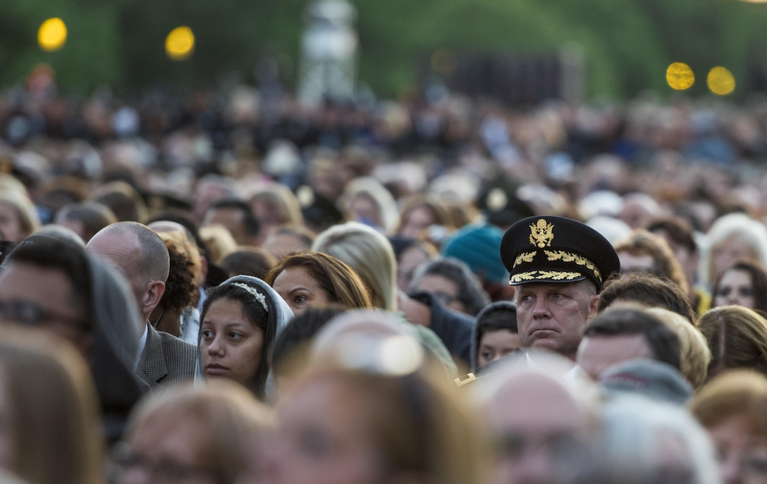 Brig. Gen. John Hussey, commander of the Great Lakes Training Division, Fort Sheridan, Illinois, attends the 29th Annual Candlelight Vigil honoring fallen police officers from around the country on the National Mall in Washington, D.C., May 13, 2017. Approximately 300 police officers' names were read, engraved into the National Police Memorial. Among those names was Staff Sgt. James D. McNaughton, a U.S. Army Reserve military police who was the first New York City police officer killed in action while deployed to Iraq, Aug. 2, 2005. (U.S. Army Reserve photo by Sgt. Audrey Hayes)