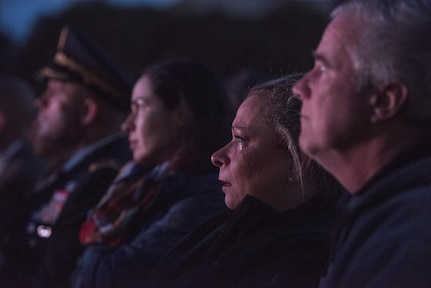 William and Michele McNaughton, from Centereach, New York, remember their son, Staff Sgt. James D. McNaughton, during the 29th Annual Candlelight Vigil, who is honored among other fallen police officers from around the country on the National Mall in Washington, D.C., May 13, 2017. McNaughton was a U.S. Army Reserve military police who was the first New York City police officer killed in action while deployed to Iraq, Aug. 2, 2005. Approximately 300 police officers' names were read, engraved into the National Police Memorial. (U.S. Army Reserve photo by Sgt. Audrey Hayes)