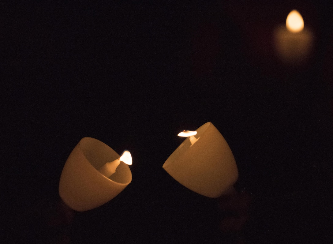 The flames of candles light up the dark during the 29th Annual Candlelight Vigil honoring fallen police officers from around the country on the National Mall in Washington, D.C., May 13, 2017. Approximately 300 police officers' names were read, engraved into the National Police Memorial. Among those names was Staff Sgt. James D. McNaughton, a U.S. Army Reserve military police who was the first New York City police officer killed in action while deployed to Iraq, Aug. 2, 2005. (U.S. Army Reserve photo by Sgt. Audrey Hayes)
