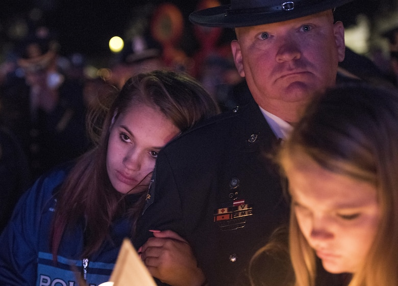 Police officers and family members attend the 29th Annual Candlelight Vigil honoring fallen police officers from around the country Saturday, on the National Mall in Washington, D.C., May 13, 2017. Approximately 300 police officers' names were read, engraved into the National Police Memorial. Among those names was Staff Sgt. James D. McNaughton, a U.S. Army Reserve military police who was the first New York City police officer killed in action while deployed to Iraq, Aug. 2, 2005.