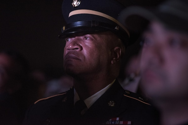 Command Sgt. Maj. Craig Owens, the senior enlisted leader for the 200th Military Police Command, attends the 29th Annual Candlelight Vigil honoring fallen police officers from around the country on the National Mall in Washington, D.C., May 13, 2017. Approximately 300 police officers' names were read, engraved into the National Police Memorial. Among those names was Staff Sgt. James D. McNaughton, a U.S. Army Reserve military police who was the first New York City police officer killed in action while deployed to Iraq, Aug. 2, 2005. (U.S. Army Reserve photo by Sgt. Audrey Hayes)