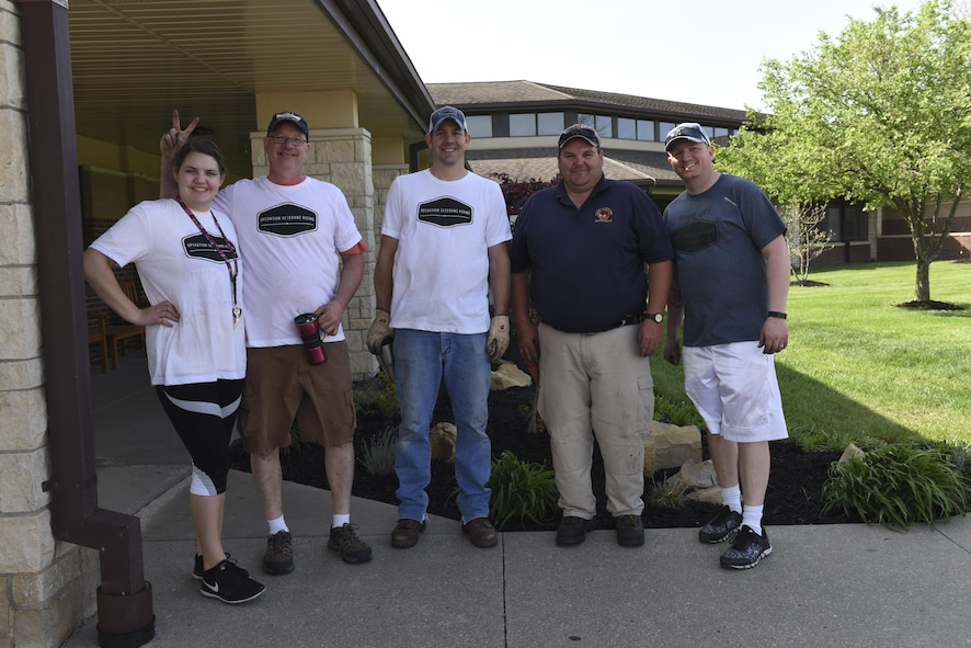Operations Veterans Rising volunteers beautify the exterior of the Warrensburg Veterans Home, Mo., April 15, 2017. The Operation Veterans Rising is a non-profit organization created to help veterans and their families rise up from their daily struggles through a variety of financial aid programs.  (U.S. Air Force photo/ Senior Airman Danielle Quilla)