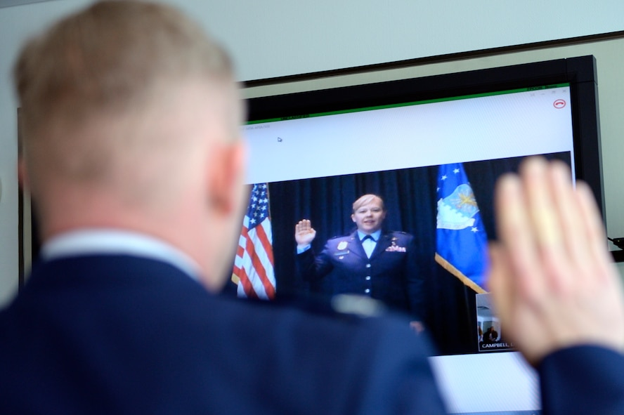 Col. Joseph McFall, 52nd Fighter Wing commander, promotes his sister, Theresa Goodman, to the rank of colonel via video teleconferencing technology, May 15, 2017 at Spangdahlem Air Base, Germany. Goodman is a medical inspector at the Air Force Inspection Agency headquarters at Kirtland Air Force Base, New Mexico, 5296 miles away from Spangdahlem. (U.S. Air Force photo by Tech. Sgt. Staci Miller)