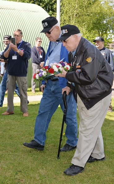 Veterans of the 100th Bombardment Group (Heavy), Master Sgt. (retired) Dewey Christopher, center, and Staff Sgt (retired) Joe Urice, right, prepare to lay a wreath May 10, 2017, at Parham Airfield Museum, Framlingham, Suffolk. The 100th Bomb Group veterans visited England with family members and others from the 100th BG Foundation as part of the 100th anniversary of the 100th BG and 25th anniversary of the 100th Air Refueling Wing and toured former East Anglian World War II bases including Thorpe Abbots, Horham and Rattlesden. (U.S. Air Force photo by Karen Abeyasekere)