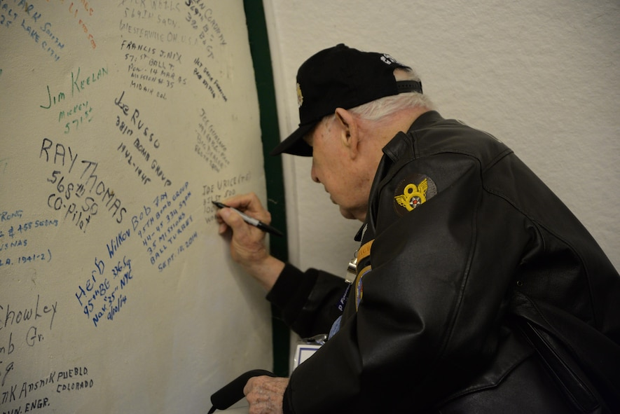 "Staff Sgt. (retired) Joe Urice, 100th Bombardment Group (Heavy) veteran and former B-17 tailgunner, signs his name on the ""Heroes Wall of Fame"" May 10, 2017, at Parham Airfield Museum, England. The museum is one of many around East Anglia dedicated to the men who served during World War II.  Veterans of the 100th BG and their families, along with Team Mildenhall members, spent the day visiting former East Anglian bases in Horham, Parham and Thorpe Abbots. The 100th BGF members also visited RAF Mildenhall, Madingley American Cemetery and Duxford War Museum during their trip to celebrate the 100th BG's 75th anniversary. (U.S. Air Force photo by Karen Abeyasekere)"