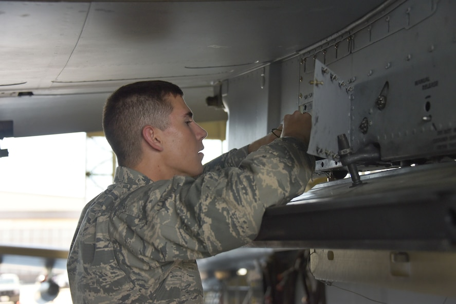 Airman Colton Curry, 363rd Training Squadron A-10 students, learns how to remove and install a dual rail adapter on station one of the A-10 aircraft at Sheppard Air Force Base, Texas, March 23, 2017. This training course lasts approximately 68 days. (U.S. Air Force photo by Liz H. Colunga/Released)