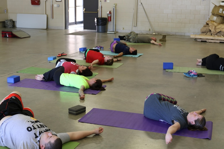 Members of the 103rd Sustainment Command (Expeditionary) participate in a Yoga session with Olivia Kvitne on May 12, 2017 at Fort Des Moines, Iowa.  Kvitne is founder of Yoga for First Responders which focuses on providing Yoga as a tool to relieve stress for veterans and those who have experienced post-traumatic stress disorder.  (Released/U.S. Army photo by Capt. Charles An)