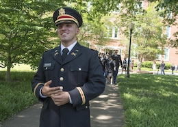 Brand new U.S. Army 2nd Lt. Allen Robertson walks across the Clemson University campus to propose to his girlfriend, Chelsea Campbell, after his Reserve Officers' Training Corps commissioning ceremony, May 10, 2017. The two met while they were students at Clemson and will both graduate this week. Robertson, who hails from Mooresville, N.C., earned a degree in accounting at Clemson and his first duty station will be with at Fort Campbell, Ky. with the 101st Airborne Division. Campbell, of Fort Mill, S.C., earned her degree in psychology. (U.S. Army Reserve photo by Staff Sgt. Ken Scar)
