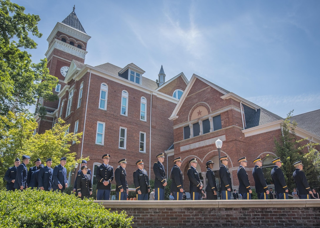 Brand new U.S. Army and Air Force second lieutenants line up in front of  Clemson University's Tillman Hall to recieve their first salutes after being commissioned in a Reserve Officers' Training Corps ceremony, May 10, 2017. (U.S. Army Reserve photo by Staff Sgt. Ken Scar)
