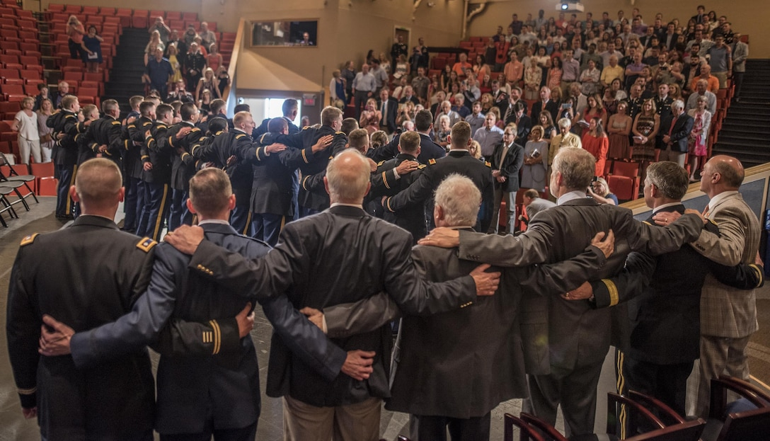 Attendees sing the Clemson University alma mater during a Reserve Officers' Training Corps commissioning ceremony in the Tillman Hall auditorium, May 10, 2017. (U.S. Army Reserve photo by Staff Sgt. Ken Scar)