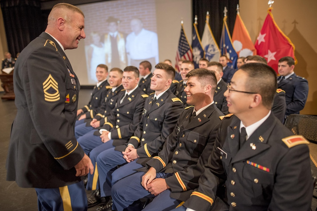 U.S. Army Master Sgt. Shane Werst, of Lake Forest, Cali., the senior military leadership instructor for Clemson University's Reserve Officers' Training Corps program, shares a moment with 26 very-soon-to-be second lieutenants before their commissioning ceremony, May 10, 2017 (U.S. Army Reserve photo by Staff Sgt. Ken Scar)