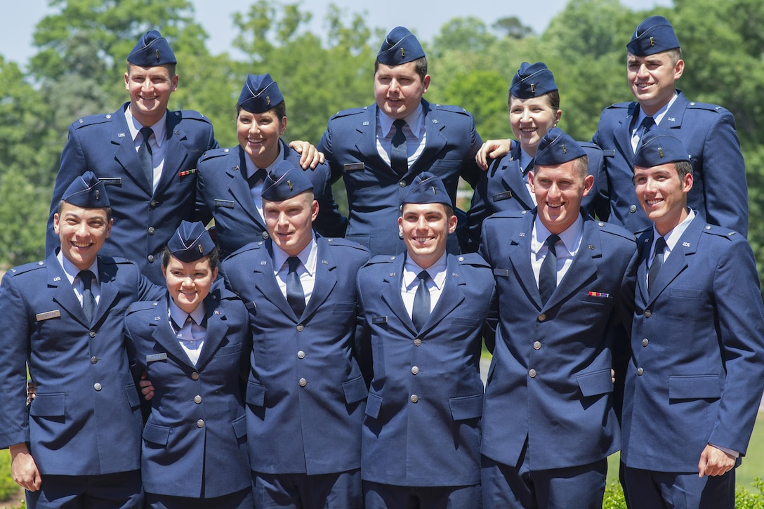 Eleven brand new U.S. Air Force second lieutenants pose for pictures after their commissioning ceremony at Clemson University, May 10, 2017. (U.S. Army Reserve photo by Staff Sgt. Ken Scar)