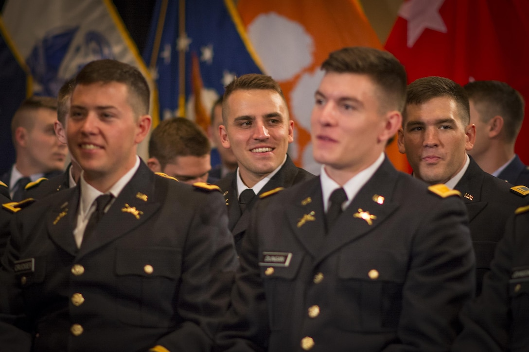 U.S. Army Reserve Officers' Training Corps cadet Allen Robertson - soon to be 2nd Lt. Robertson - plays it cool during Clemson University's Reserve Officers' Training Corps commissioning ceremony, May 10, 2017. Robertson proposed to his girlfriend, Chelsea, immediately after this ceremony. (U.S. Army Reserve photo by Staff Sgt. Ken Scar)