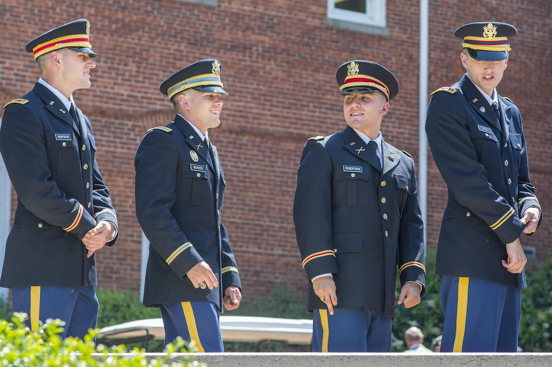 Brand new U.S. Army 2nd Lt. Allen Robertson (second from right) hobnobs with three of his fellow Clemson University Reserve Officers' Training Corps graduates as they wait to receive their first salutes in a Silver Dollar Ceremony, May 10, 2017.  (U.S. Army Reserve photo by Staff Sgt. Ken Scar)