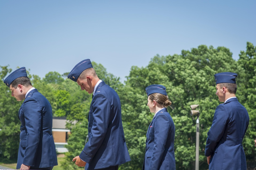 Four brand new U.S. Air Force second lieutenants prepare to receive their first salutes as officers during a Silver Dollar Ceremony on Clemson University's Military Heritage Plaza, May 10, 2017. (U.S. Army Reserve photo by Staff Sgt. Ken Scar)