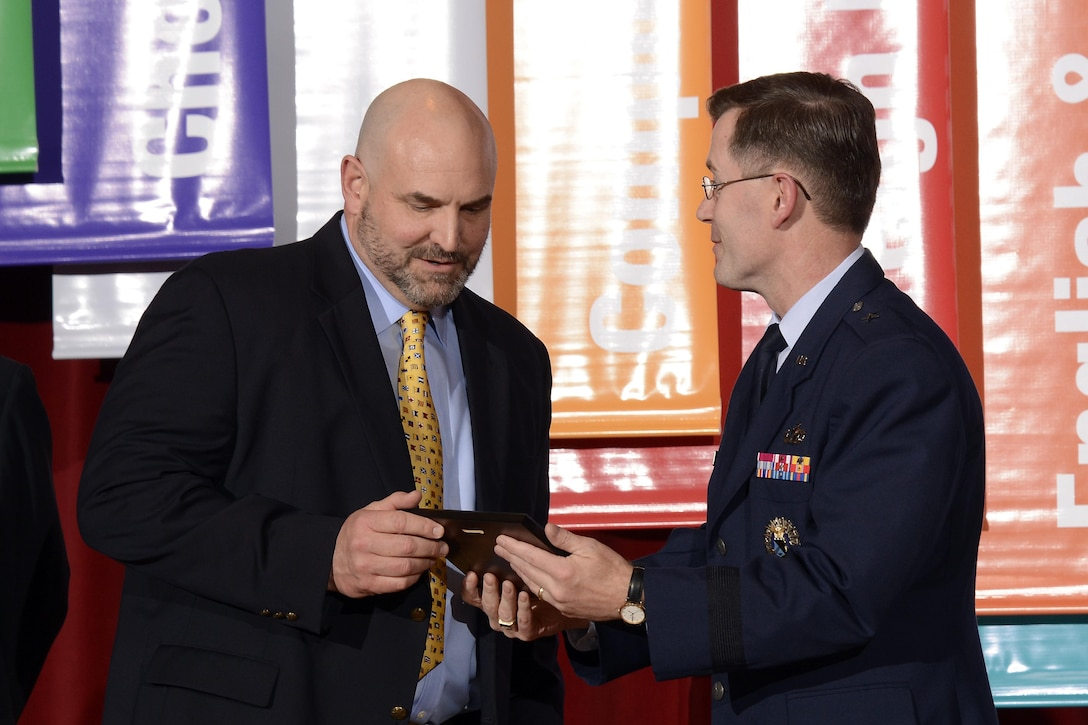 Charles Steele receives the Heiser Award from Dean of Faculty Brig. Gen. Andrew Armacost, May 5, 2017 at the U.S. Air Force Academy. Steele is a history professor at the Academy. The Heiser award is named after Professor Emeritus Dr. William H. Heiser and given to faculty members who contribute to cadets' development. (U.S. Air Force photo/Darcie Ibidapo)