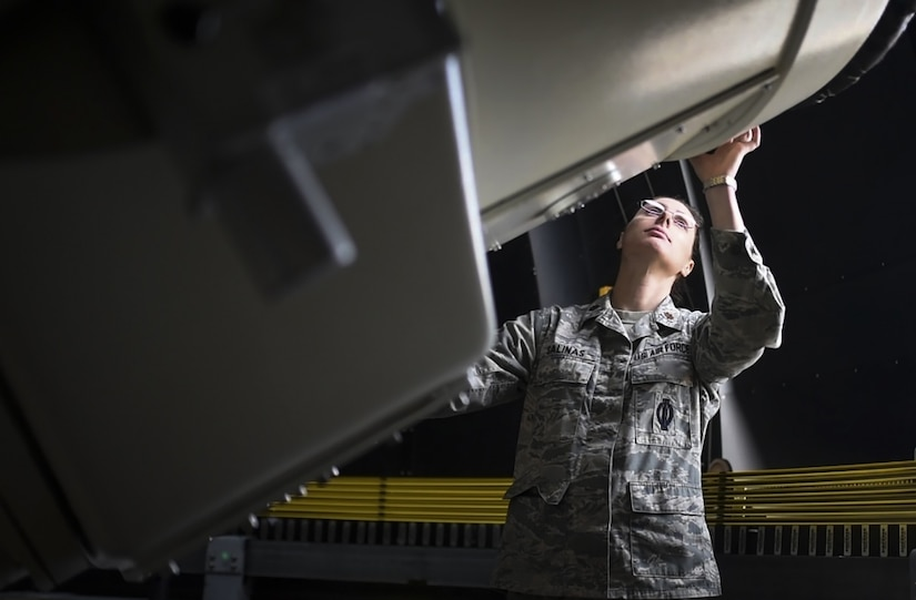 Air Force Maj. Erin Salinas demonstrates the mobility of a Ground-Based Electro-Optical Deep-Space Surveillance telescope at White Sands Missile Range, N.M., April 27, 2017. Air Force photo by Airman 1st Class Dennis Hoffman