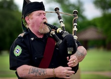 Tim Macleod, a ceremonial bagpipes player, performs during the National Police Week opening ceremony at Joint Base Langley-Eustis, Va., May 15, 2017. National Police week honors military and civilian law enforcement officers who paid the ultimate sacrifice in the line of duty. (U.S. Air Force photo/Staff Sgt. Areca T. Bell)