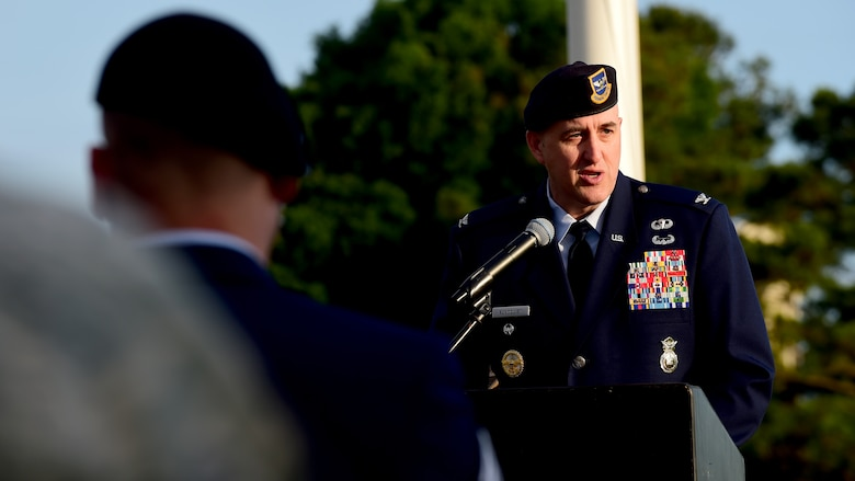 U.S. Air Force Col. Erik Rundquist, Air Combat Command chief of security forces, speaks during the National Police Week opening ceremony at Joint Base Langley-Eustis, Va., May 15, 2017. In 1962, President John F. Kennedy signed Public Law 87-726 designating May 15 as Peace Officers' Memorial Day, and the week in which May 15 falls as National Police Week. (U.S. Air Force photo/Staff Sgt. Areca T. Bell)