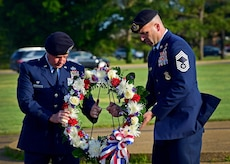 Lt. Col. Timothy McCarty, 633rd Security Forces Squadron commander, and Chief Master Sgt. Kevin Range, 633rd SFS manager, present a wreath during the National Police Week opening ceremony at Joint Base Langley-Eustis, Va., May 15, 2017. Established by a joint resolution of Congress in 1962, National Police Week pays special recognition to those law enforcement officers who lost their lives in the line of duty for the safety and protection of others. (U.S. Air Force photo/Staff Sgt. Areca T. Bell)