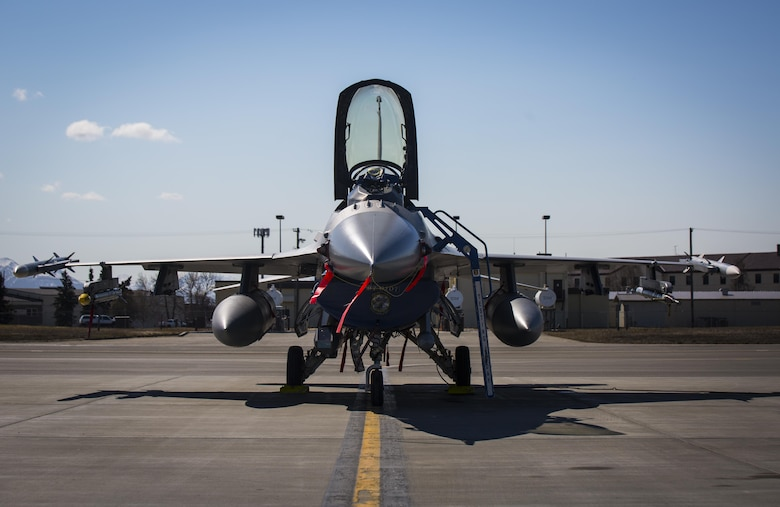 A U.S. Air Force F-16C Fighting Falcon aircraft with the 96th Test Wing based out of Eglin Air Force Base gets preflight operational checks at Joint Base Elmendorf-Richardson, Alaska, for exercise Northern Edge 2017, May 5, 2017. This exercise is Alaska's largest and premier joint training exercise designed to practice operations, techniques and procedures, as well as enhance interoperability among the services. The exercise provides real-world proficiency in detection and tracking of units at sea, in the air and on land and response to multiple crises in the Indo-Asia-Pacific region. (U.S. Marine Corps photo by Lance Cpl. Andy Martinez)