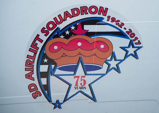 The newly unveiled commemorative logo on the nose of a C-17 Globemaster III at the 3d Airlift Squadron 75TH Anniversary Nose Art Unveiling Ceremony May 12, 2017, at Dover Air Force Base, Del. The logo will be made into a patch that squadron members can wear on Fridays. (U.S. Air Force photo by Mauricio Campino)