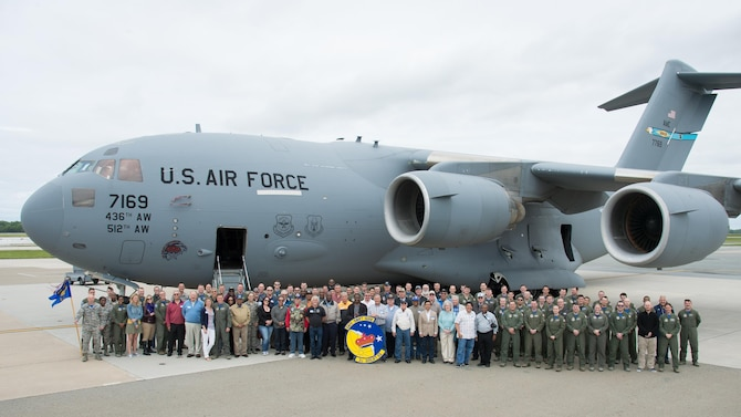 Current and former squadron members pose for a group photo with a C-17 Globemaster III at the 3d Airlift Squadron 75TH Anniversary Nose Art Unveiling Ceremony May 12, 2017, at Dover Air Force Base, Del. Over 150 former squadron member and their families visited Dover AFB for the ceremony. (U.S. Air Force photo by Mauricio Campino)