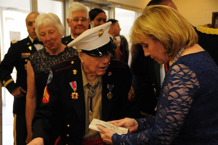 """New Jersey Lt. Gov. Kim Guadagno greets Frank Gross, a Korean War veteran, May 12 during the U.S. Army Reserve's 99th Regional Support Command dining out on Joint Base McGuire-Dix-Lakehurst, New Jersey.  The theme of the event was """"Veterans: Then and Now.""""  More than 100 veterans from area veteran homes were invited to attend."""